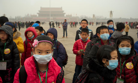 Children wear masks as a thick haze of air pollution envelopes Tiananmen Square in January.?